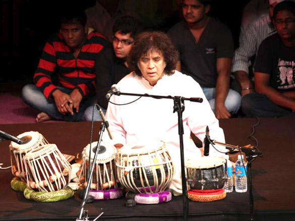 Zakir Hussain performs on the stage