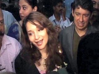 Madhuri with her husband at mumbai airport