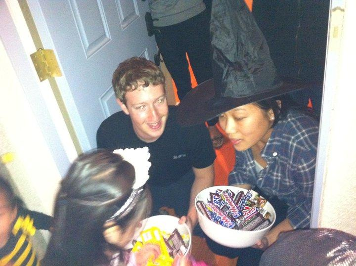 Mark Zuckerberg and girlfriend Priscilla Chan giving out candies in Halloween