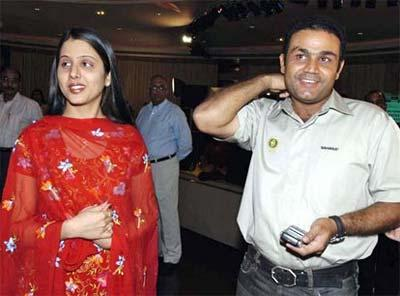 Virender Sehwag with wife Aarti out for a party