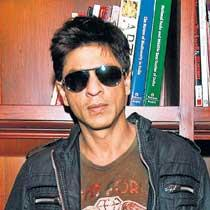 Shah Rukh Khan hot pose wearing goggles