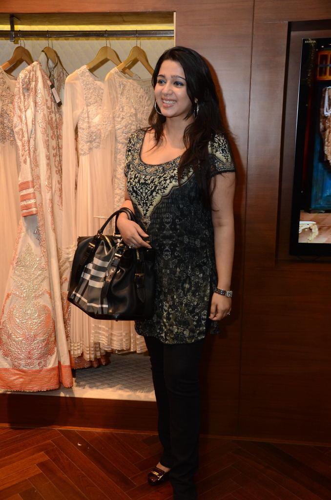 Telugu Actress Charmy Smiling Pose At Shantanu And Nikhil Designer Store Launch