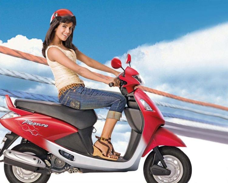Priyanka Chopra Riding Scooty Ad Wallpaper