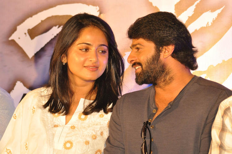 Prabhas And Anushka Cool Discussion Still At Mirchi Movie Success Meet