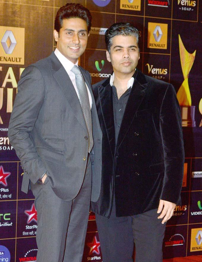 Abhishek With Karan Pose For The Shutterbugs At Star Guild ...