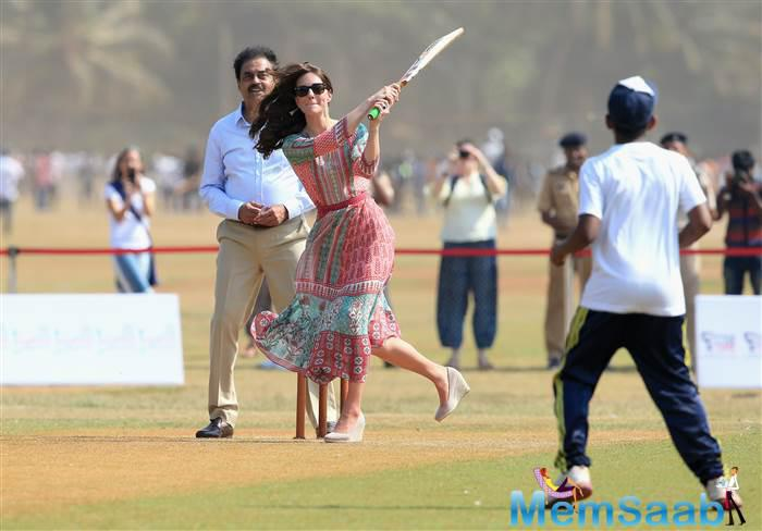 The Duchess of Cambridge, the former Kate Middleton, gestures as she plays cricket during a charity event at the Oval Maidan in Mumbai, India, April 10, 2016.