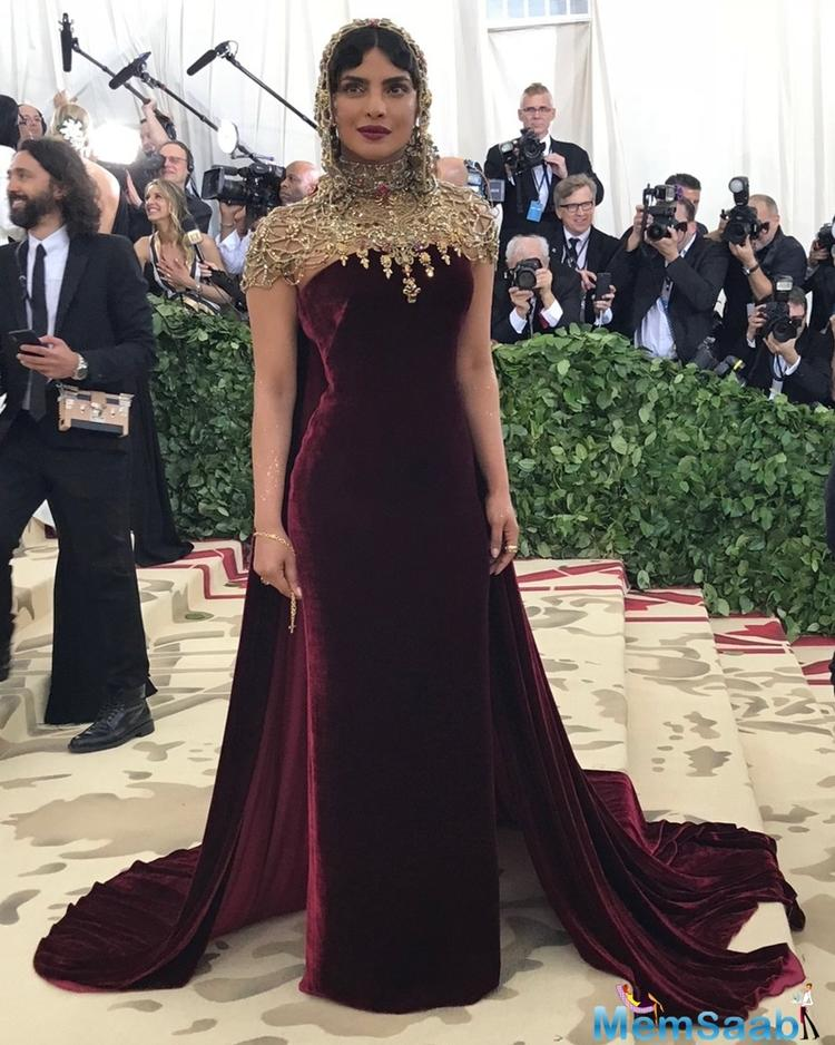 Donning a Ralph Lauren velvet evening gown, PC was in sync with this ...