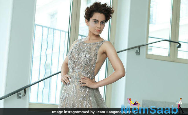 Kangana Ranaut lived up to her 'bold and beautiful' image as she made her Cannes Film Festival red carpet debut in a sheer, embellished and backless gown in the French Riviera on Thursday.