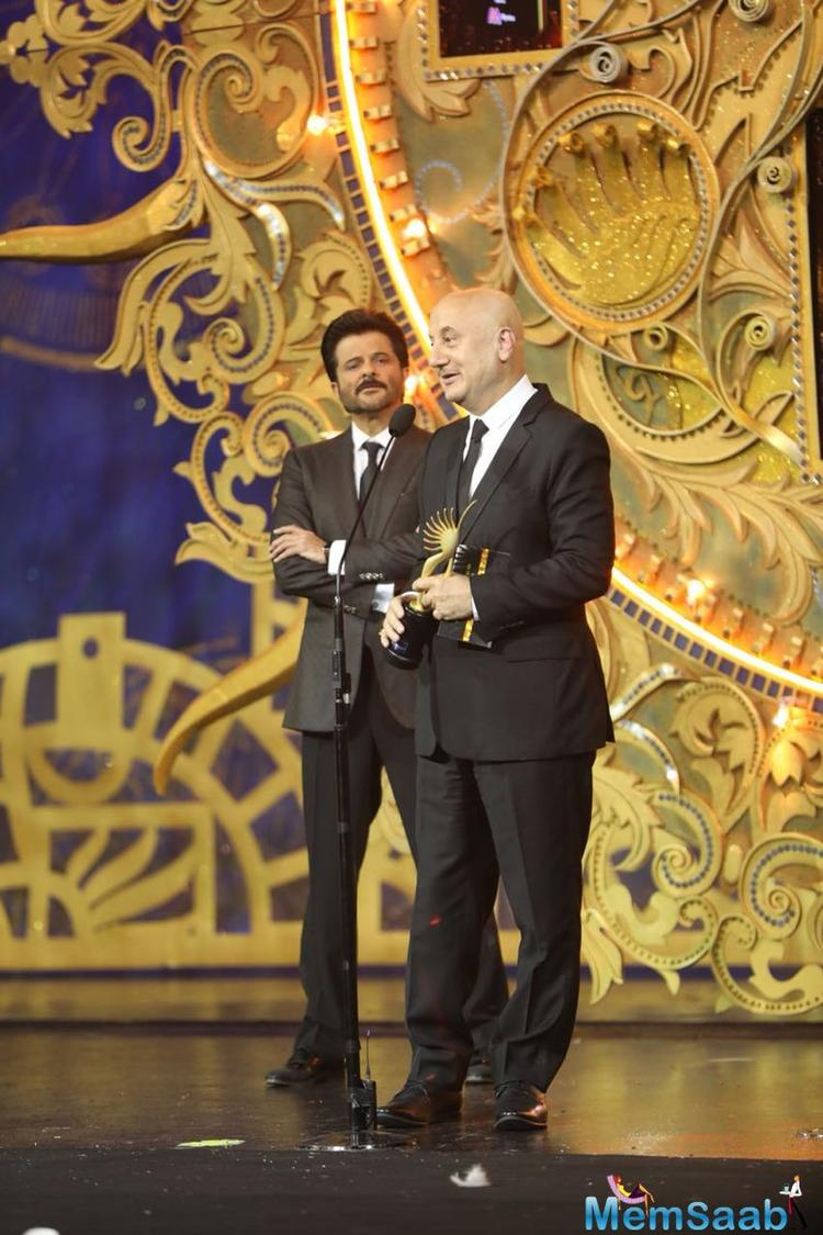 Veteran actor Anupam Kher was honoured with the Outstanding Achievement award by his co-star of many films, Anil Kapoor.