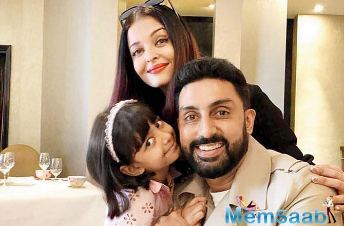In another photo shared by Aish, she is seen kissing Aaradhya with the iconic magic castle in the background. The actress has time and again stated that her life revolves around her