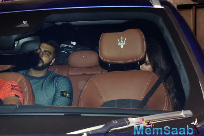 Malaika Arora and Arjun Kapoor are throwing caution to the wind. The two were spotted exiting designer Sandeep Khosla's bash over the weekend together.