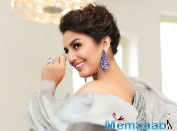 Huma Qureshi stuns the red carpet in her grey metallic gown