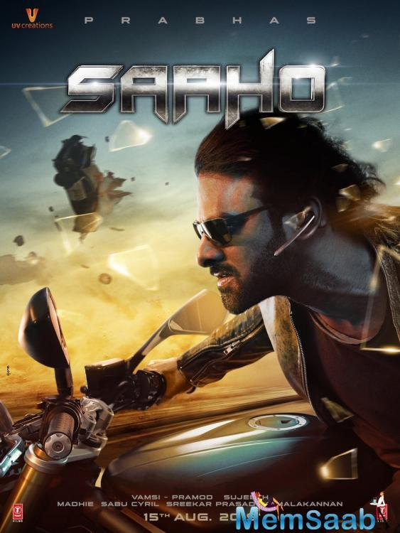 The first poster is quite captivating, killer and we just can't get enough of Prabhas' look.