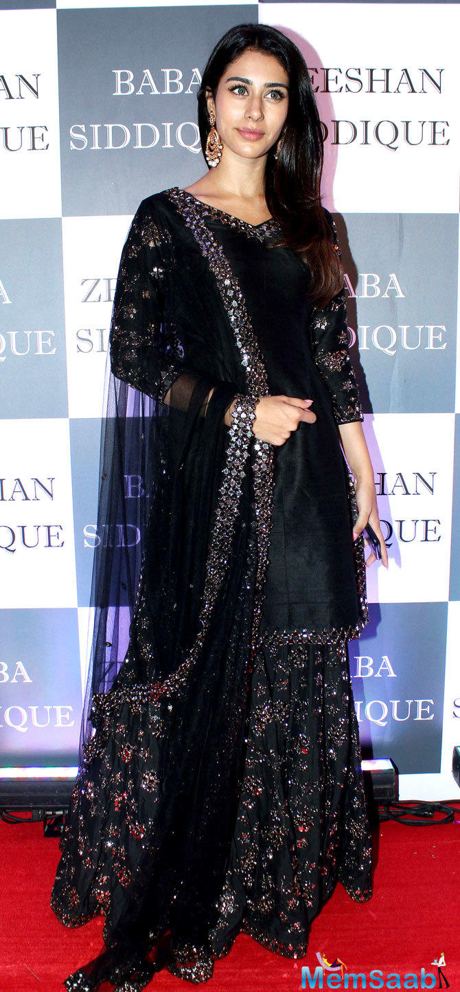 Loveyatri actress Warina Hussain looked stunning in a shimmery black sharara set.