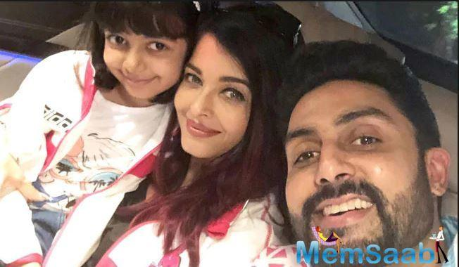Aishwarya and Abhishek soak in the sun in NYC as they pose with their fans; See Pic