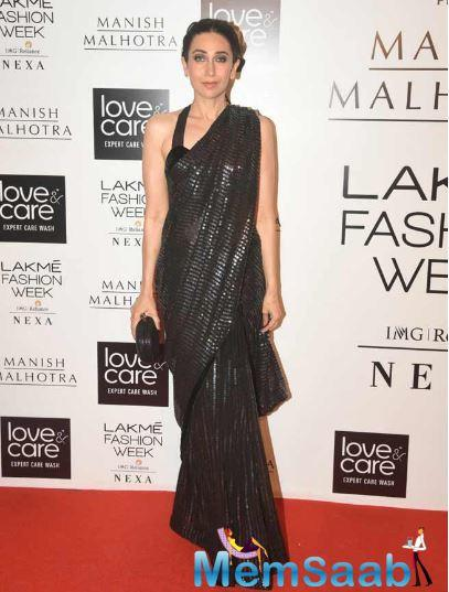 Karisma Kapoor looked all sorts of fabulous in a sequinned black sari, paired with a halterneck blouse.