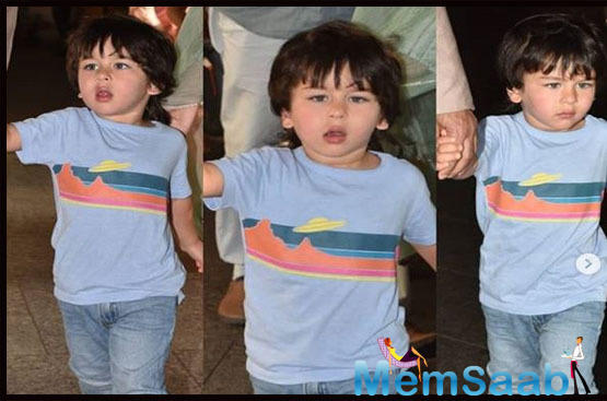 Taimur Ali Khan sipping on his drink alongside Saif and Kareena Kapoor will make your day